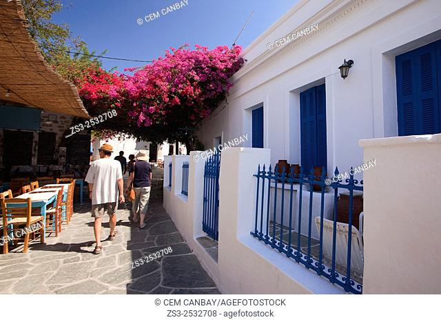 Tourists near the whitewashed houses with colorful balconies and windows in Hora, Folegandros, Cyclades Islands, Greek Islands, Greece, Europe