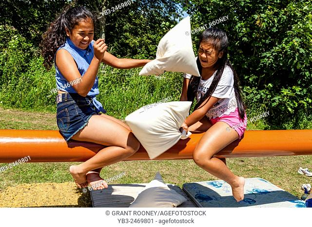 Two Sisters Having A Pillow Fight, Kingston Village Fete, Kingston, Sussex, UK