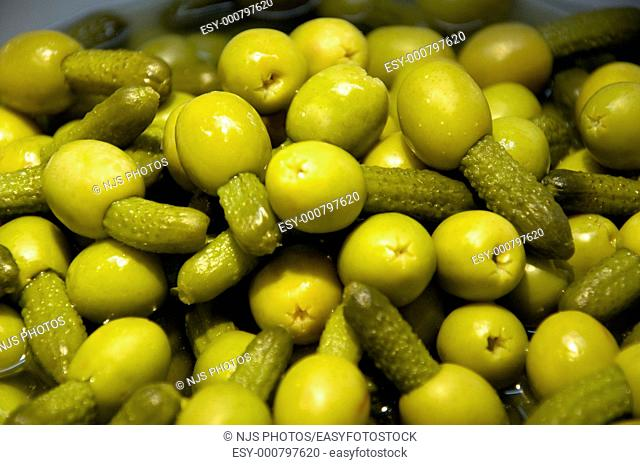 Green olives with little gherkins in a stand, San Miguel Market, Madrid, Spain