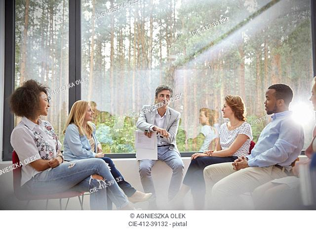 Therapist leading group therapy session