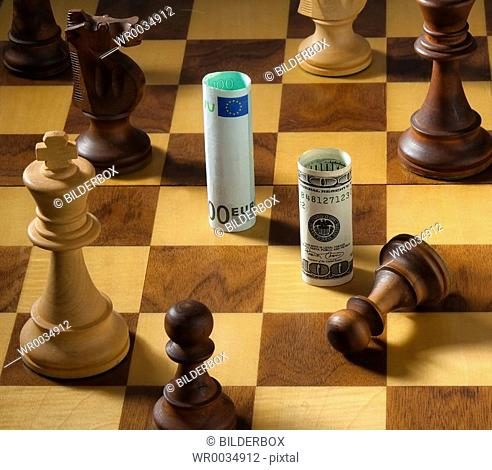 Chess with dollar and euro bank note. Icon for devaluation of the dollar against euro