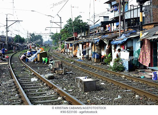 Rail tracks passing through slum area. Djakarta, Indonesia