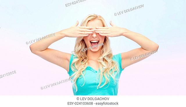 emotions, expressions and people concept - smiling young woman or teenage girl covering her eyes with palms over rose quartz and serenity gradient background