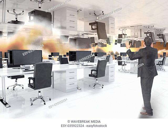 man standing in inverted office in clouds