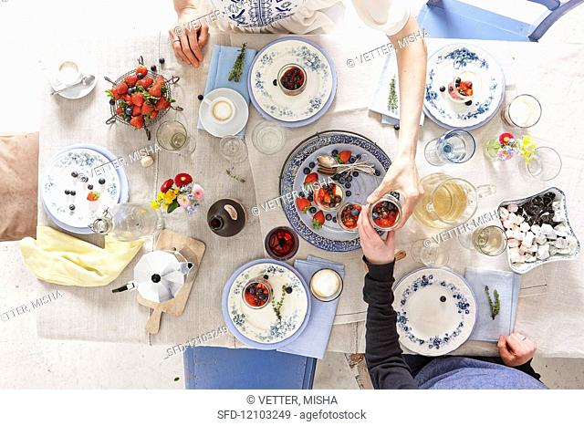 A table set with fruit dessert and coffee