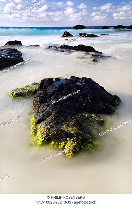 Hawaii, Big Island, Kona Coast, Kua Bay, seaweed encrusted rocks slow shutter