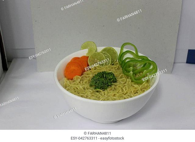 Instant Noodles with Vegetables, Green Chili, Carrots, Broccoli and Lime in Bowl