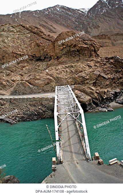 Bridge on indus river connecting leh kargil road ; Ladakh ; Jammu and Kashmir ; India 9-April-2008