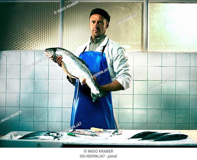 Fishmonger holding a salmon