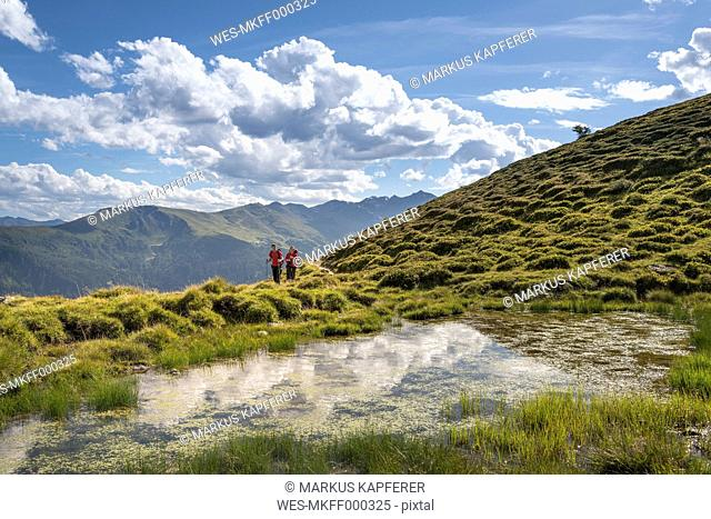 Couple hiking in the Alps