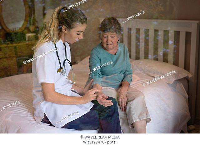 Physiotherapist examining a senior woman