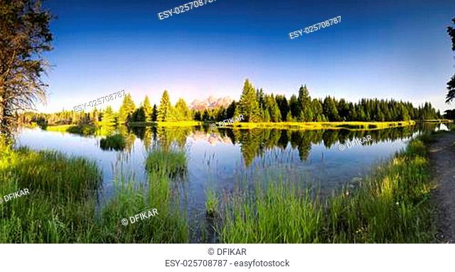 Early morning panoramic view of the Snake River and Tetons in Wyoming
