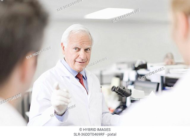 Scientist teaching in pathology lab