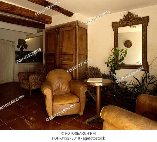 Leather armchairs in country living room