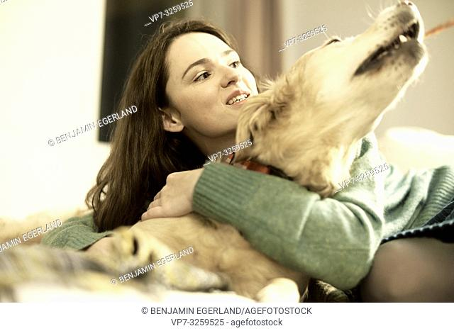 woman with dog at home, in Munich, Germany