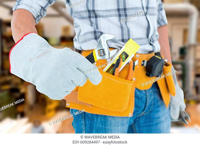 Composite image of technician using adjustable wrench against white background