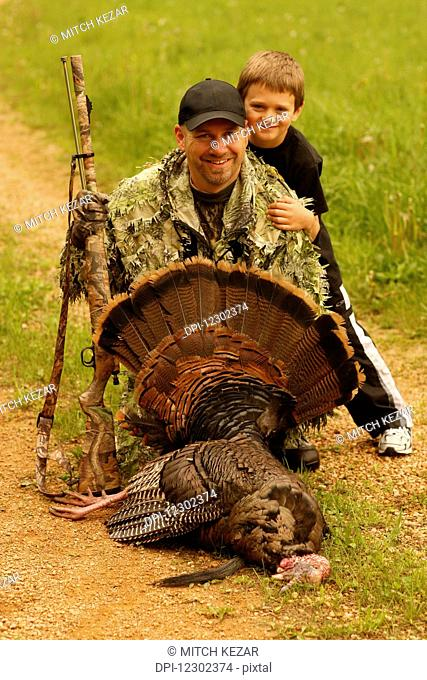 Muzzleloader Turkey Hunter And Son With Turkey