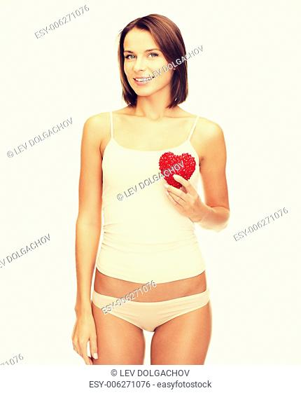 health, charity and beauty concept - beautiful woman in cotton underwear showing red heart