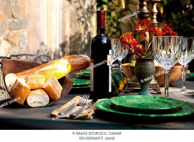Bread and wine at set table