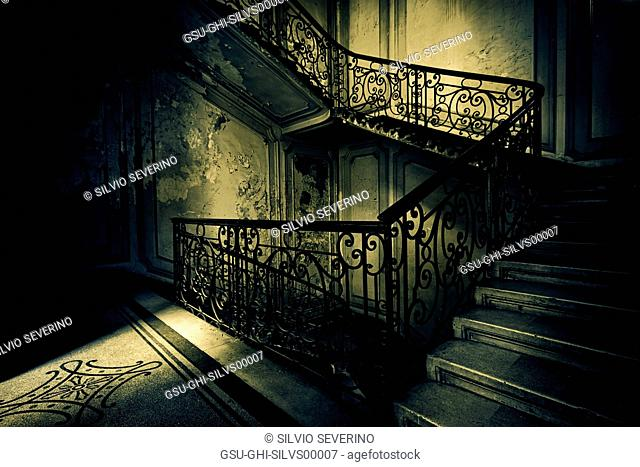Staircase in Old Building with Dramatic Light