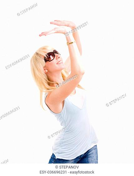 Young woman is holding something abstract above her head. Isolated on white background
