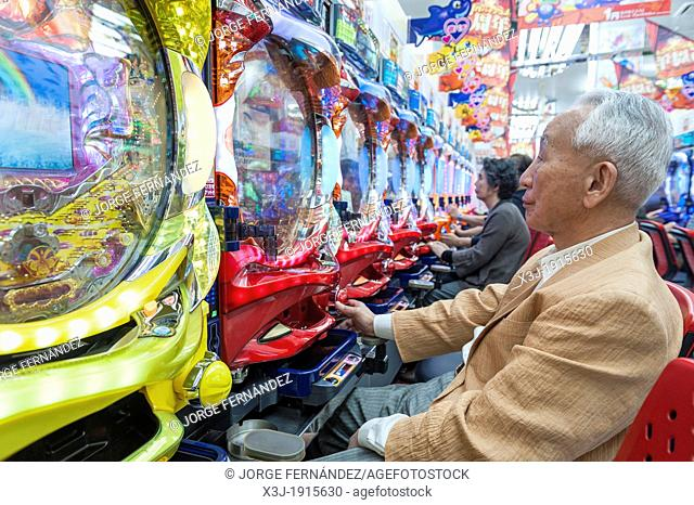 People playing pachinko, a very popular game in Japan, Tokyo, Asia