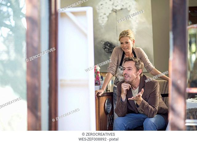 Female painter talking with customer