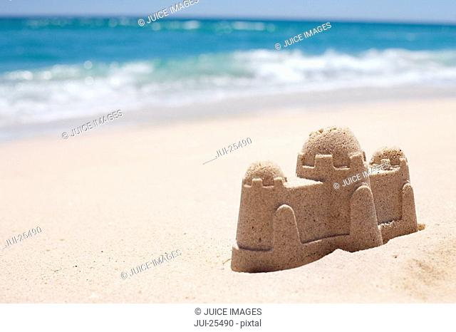 Close up of sand castle at beach near ocean