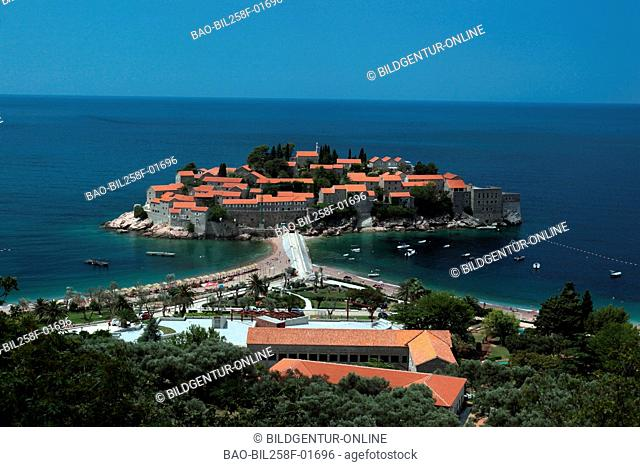 The Old Town island of Sveti Stefan in Adriatic on the coast in Montenegro in the Balkans at the Mediterranean Sea in Europe