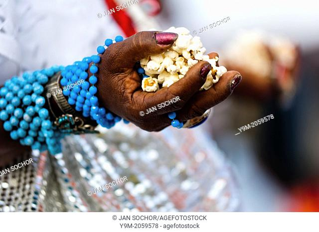 Hands of a Baiana woman seen during the 'popcorn bath', an Afro-Brazilian spiritual cleansing ritual performed in front of the St