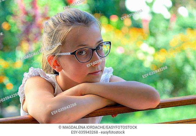 Thoughtful little girl outdoor