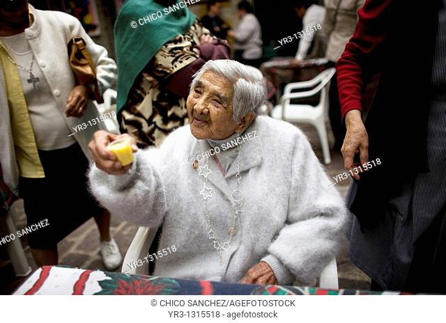 Isabel Alarcon, 100, toasts in the patio of Our Lady of Guadalupe Home for the Elderly, during the celebration of her one hundred year's old birthday in Mexico...