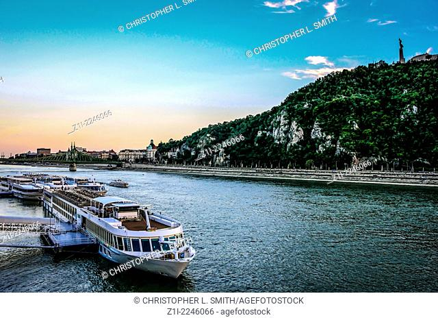 Riverboat cruisers on the Danube at sunset in Budapest