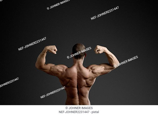 Man showing back muscles