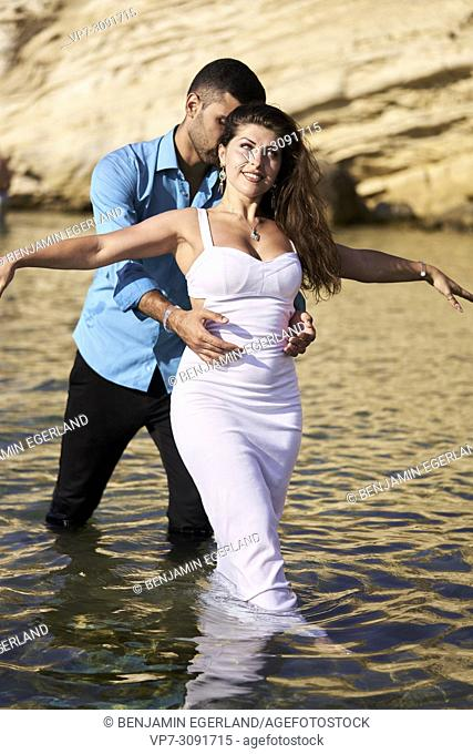 couple in sea at holiday in Chersonissos, Crete, Greece, enjoying love