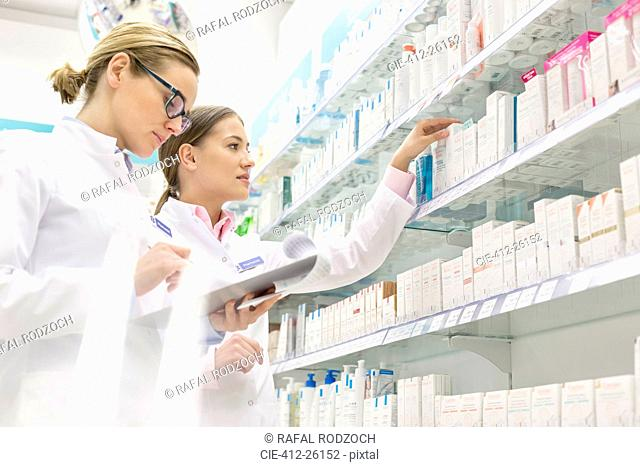 Pharmacists taking inventory in pharmacy