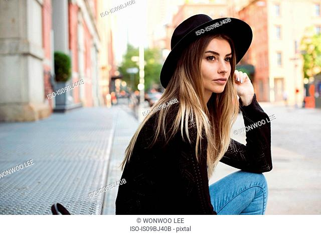 Portrait of woman wearing hat looking away, New York, USA