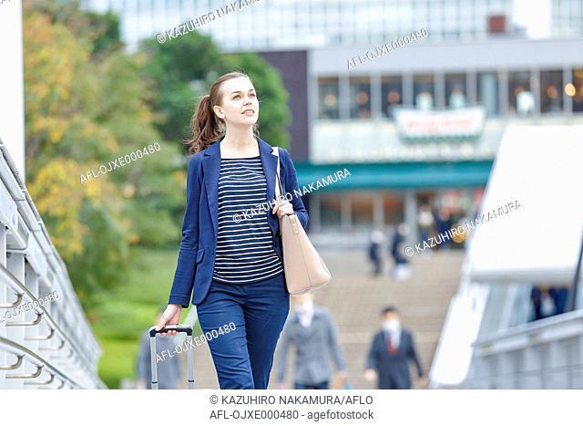 Caucasian woman downtown Tokyo, Japan