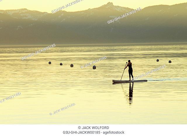 Woman on Paddle Board at Sunset, Lake Tahoe, Nevada, USA