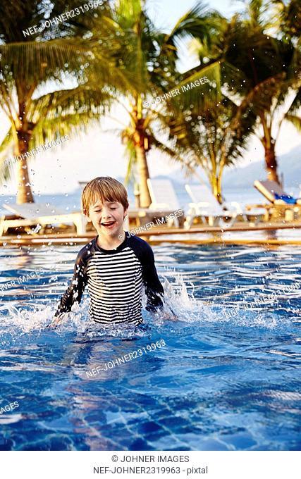 Happy boy in swimming-pool