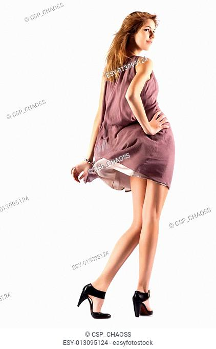 Young slim woman in fluttering dress