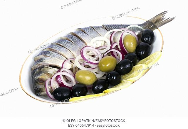 sliced â. ‹â. ‹herring with olives and lemon isolated