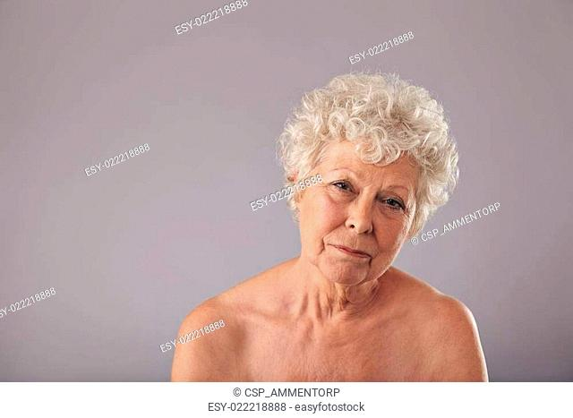 Shirtless old lady looking sad