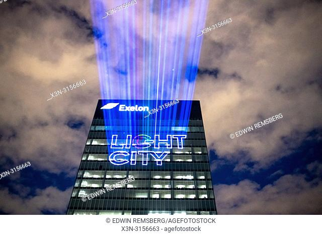 "The Exelon building with the projected words """"Light City"""" at the harbor in Baltimore, Maryland"