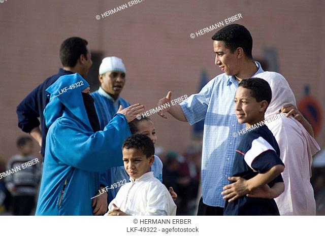 People having a conversation, Jemaa el Fna Square, Marrakech, Morocco