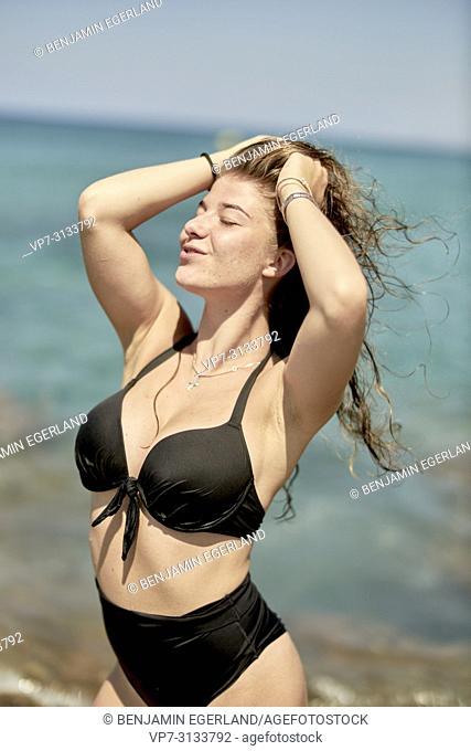 Woman at beach. Crete, Greece