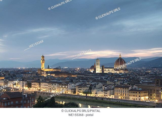 The blue light of dusk frames the city of Florence crossed by Arno River seen from Piazzale Michelangelo Tuscany Italy Europe
