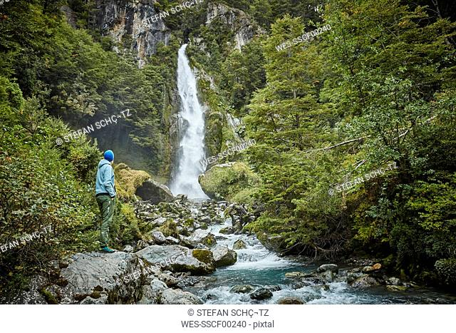 Chile, Laguna San Rafael National Park, woman admiring Las Cascadas waterfall