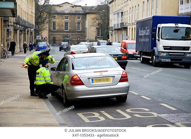 Community police officers helping a motorist with directions in Oxford
