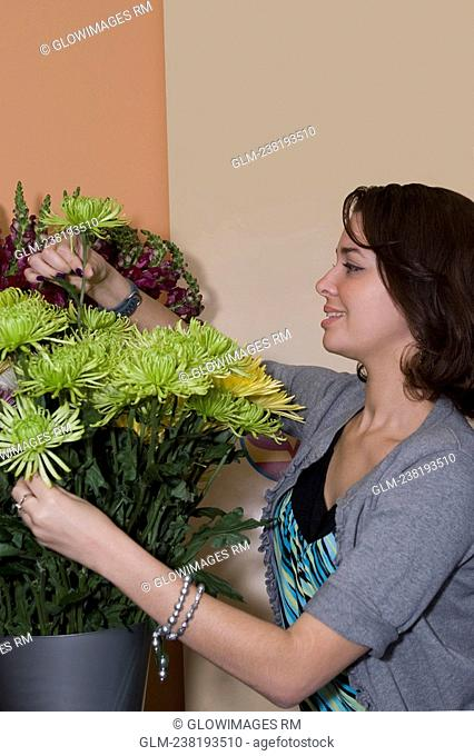 Sales clerk arranging flowers in a store, Miami, Florida, USA